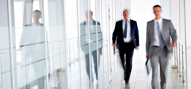 walking-in-glass-corridor